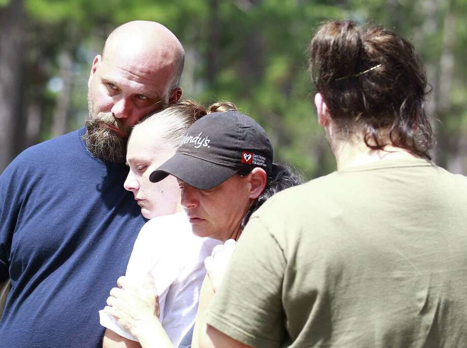 Michael Kiser (left) and his family mourn the death of his sister, Theresa Kirkpatrick, who went missing Friday. Photo: Jason Fochtman, Staff Photographer / Conroe Courier / HCN