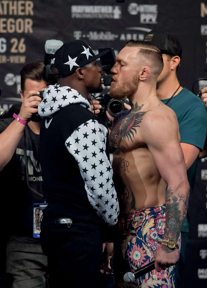 Floyd Mayweather and Conor McGregorstare each other down at a press conference at the Barclays Center in Brooklyn, on July 13, 2017. (Joel Plummer/Zuma Press/TNS) Photo: Joel Plummer, TNS