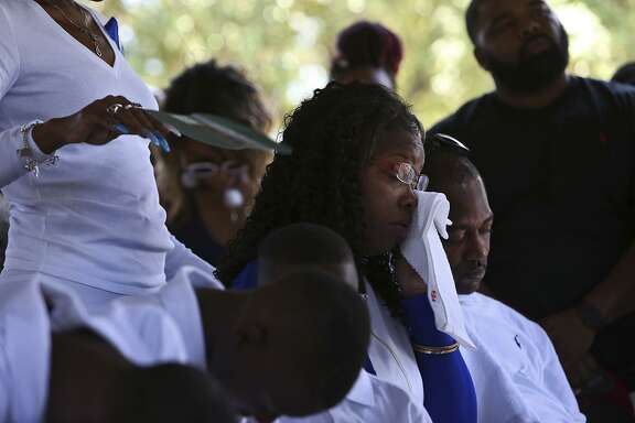 Cyntwanisha Whitley and her husband, Earl Whitley Jr., grieve for their four-year-old son, De'Earlvion Whitley, during his burial service at Meadowlawn Memorial Park on Saturday, July 29, 2017.