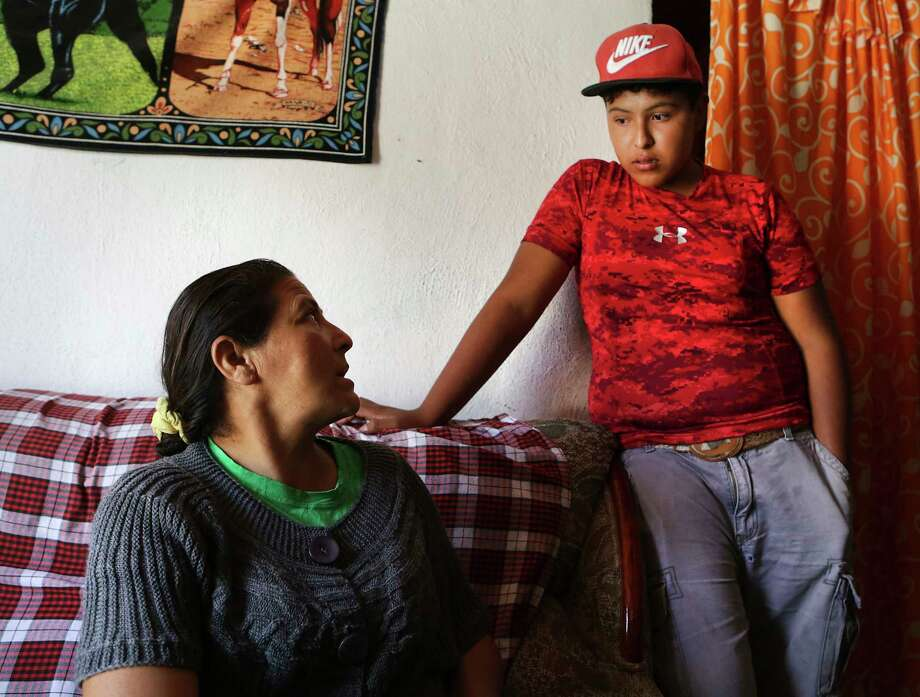 Llanira Aguilar, mother of Juan Aguilar, a victim in the human smuggling trailer, discusses the dangers of the trip with her son, Jhovanny Tiscareno Aguilar, 13, who has told her he wants to go to the United States. The two live in Palo Alto el Llano, Mexico, a small town east of Aguascalientes. Photo: Bob Owen, Staff / ©2017 San Antonio Express-News