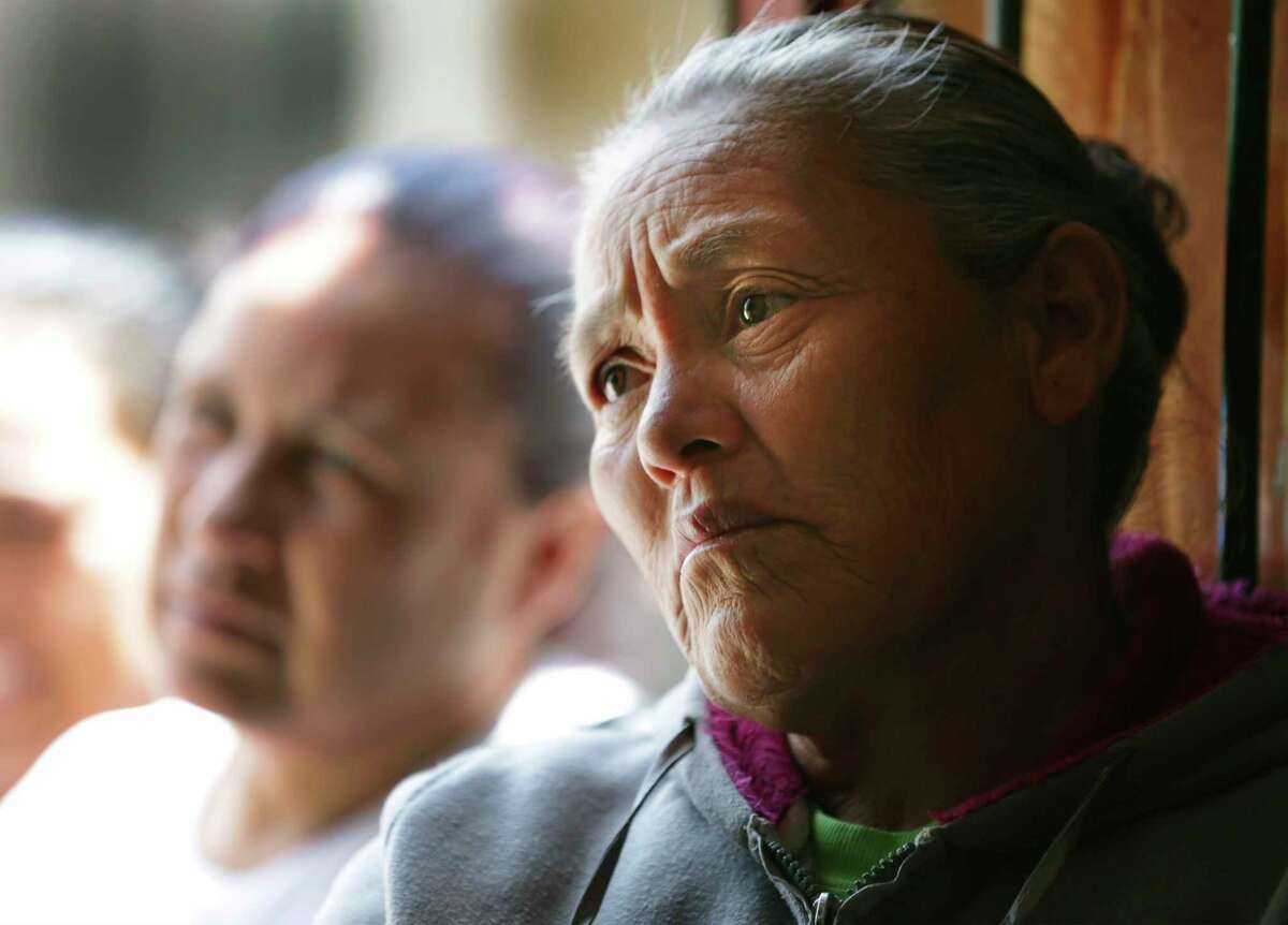 Lourdes Vega Tiscareno, mother of Adan Lara Vega, a victim from the human smuggling trailer, waits for word of her son in Palo Alto el Llano, Mexico.