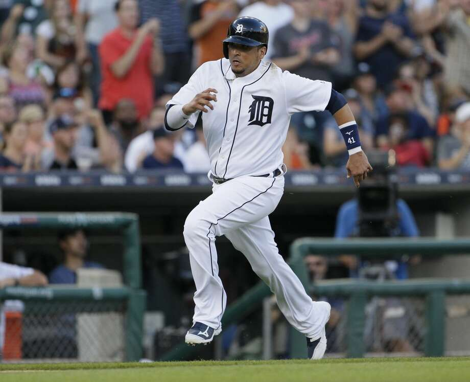 DETROIT, MI - JULY 29: Victor Martinez #41 of the Detroit Tigers scores from second base to tie the game against the Houston Astros at 4-4 during the seventh inning at Comerica Park on July 29, 2017 in Detroit, Michigan. (Photo by Duane Burleson/Getty Images) Photo: Duane Burleson/Getty Images