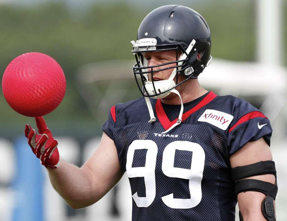 Houston Texans defensive end J.J. Watt (99) tosses a ball in the air during training camp at The Greenbrier on July 27, 2017, in White Sulphur Springs, W.Va. Photo: Brett Coomer /Houston Chronicle / © 2017 Houston Chronicle}