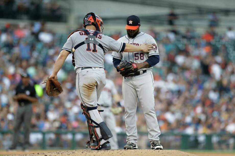 Houston Astros catcher Evan Gattis (11) talks with relief pitcher Francis Martes (58) during the seventh inning of a baseball game against the Detroit Tigers, Saturday, July 29, 2017, in Detroit. (AP Photo/Carlos Osorio) Photo: Carlos Osorio, STF / Copyright 2017 The Associated Press. All rights reserved.
