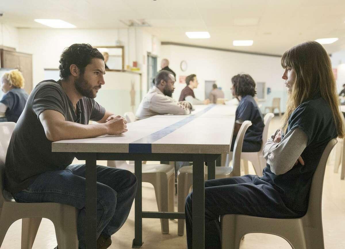 "Mason Tannetti (Christopher Abbott) visits his wife, Cora (Jessica Biel) in jail in ""The Sinner."""