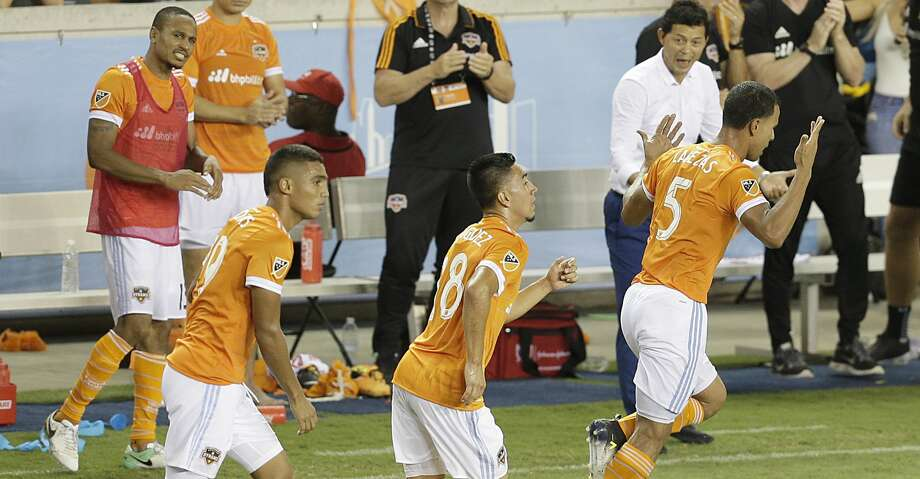 6/29/17: Houston Dynamo forward Mauro Manotas (19) and  midfielder Memo Rodriguez (18) celebrates midfielder Juan Cabezas (5) goal against the Portland Timbers in the second half in a MLS game at BBVA stadium in Houston, TX. The score ended in a 2 to 2 draw. Photo: Thomas B. Shea/For The Chronicle