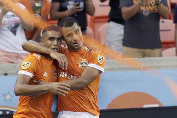 6/29/17: Houston Dynamo midfielder Juan Cabezas (5) celebrates  forward Mauro Manotas (19) goal against the Portland Timbers in the first half in a MLS game at BBVA stadium in Houston, TX.
