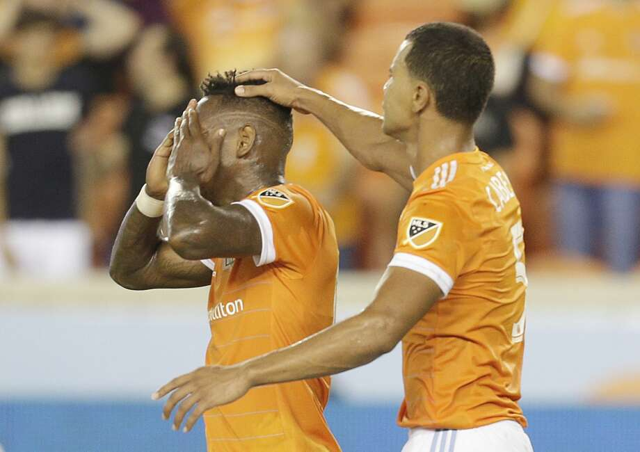 6/29/17: Houston Dynamo midfielder Juan Cabezas (5) taps forward Romell Quioto (12) on the head after Quioto misses on a scoring chance agains the Portland Timbers in the second half in a MLS game at BBVA stadium in Houston, TX. The score ended in a 2 to 2 draw. Photo: Thomas B. Shea/For The Chronicle