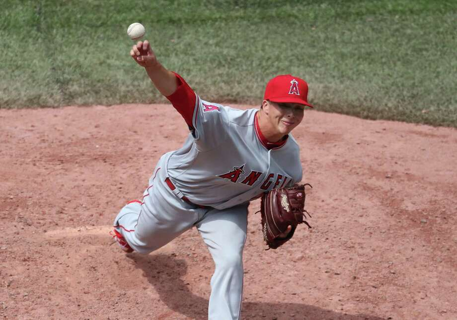 The Angels' Tro y Scribner delivers a pitch in the sixth  inning  against the Blue Jays Saturday in Toronto . The S hepaug High grad eanred a win in his major le ague  debut. Photo: Tom Szczerbowski / Getty Images / 2017 Getty Images