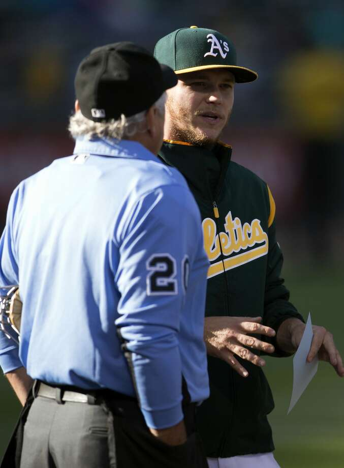 Oakland Athletics' Sonny Gray, right, talks with home plate umpire Tom Hellion before  a baseball game against the Minnesota Twins, Saturday, July 29, 2017, in Oakland, Calif. (AP Photo/D. Ross Cameron) Photo: D. Ross Cameron, Associated Press