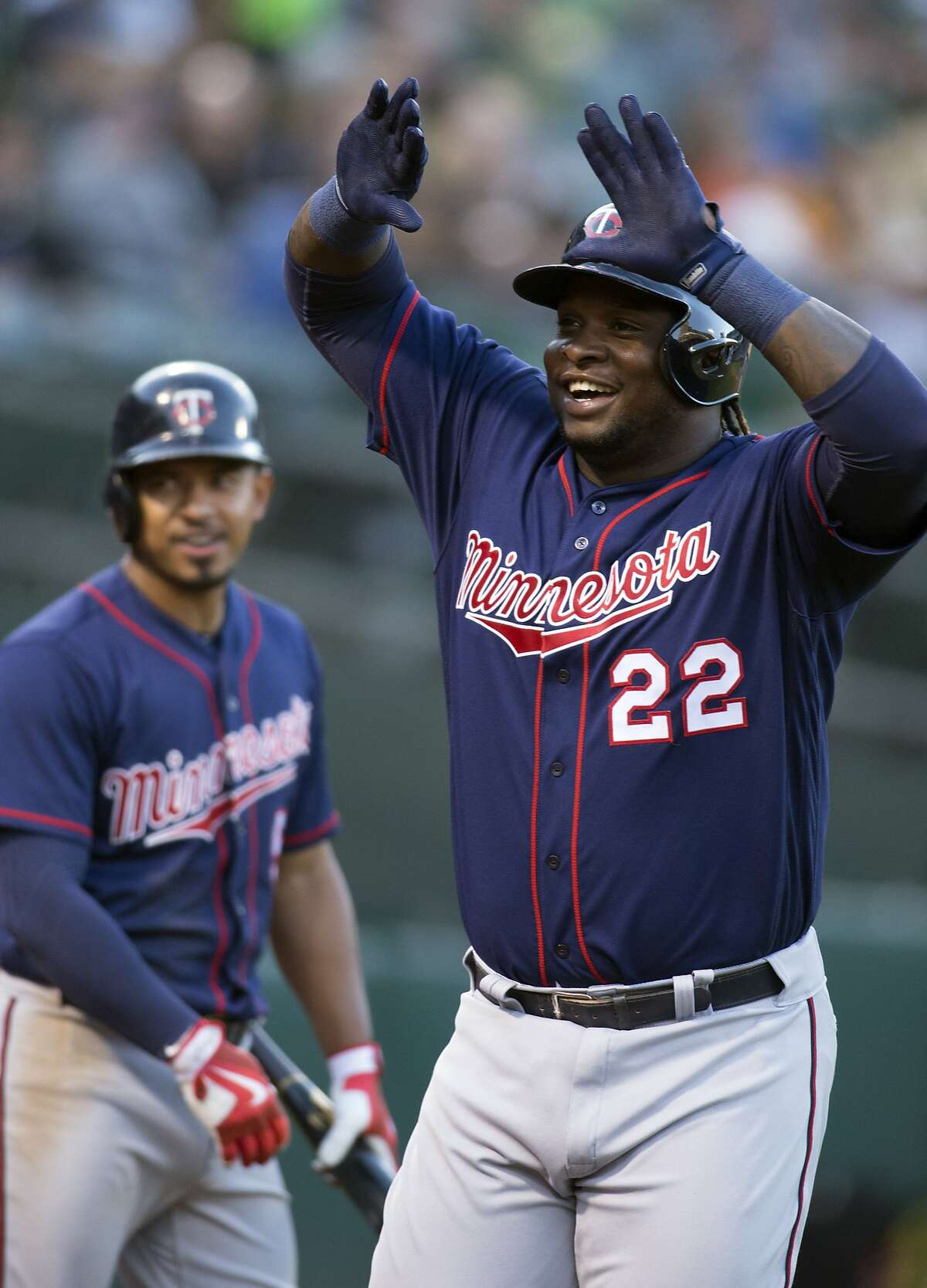 Minnesota Twins' Miguel Sano (22) celebrates his two-run home run against the Oakland Athletics during the fifth inning of a baseball game on Saturday, July 29, 2017, in Oakland, Calif. (AP Photo/D. Ross Cameron)