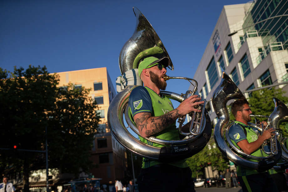 Blue Thunder marches through the Seafair Torchlight Parade on Saturday, July 29, 2017. Photo: GRANT HINDSLEY, SEATTLEPI.COM / SEATTLEPI.COM