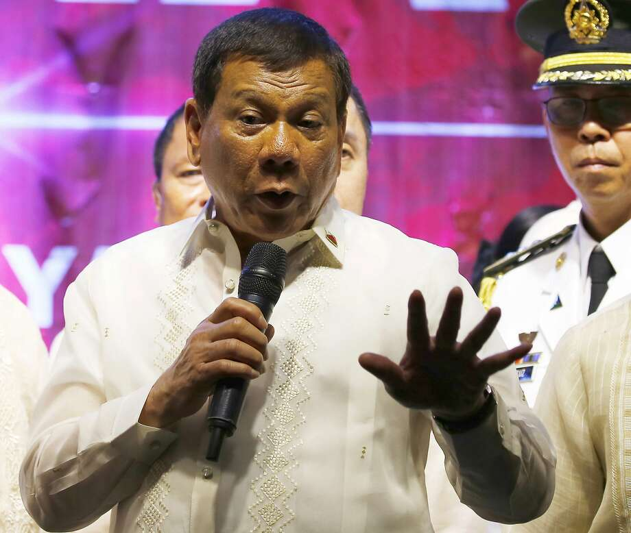 FILE - In this Monday, July 24, 2017, file photo, Philippine President Rodrigo Duterte addresses thousands of protesters following his state of the nation address outside the Lower House in Quezon city, northeast of Manila, Philippines. Philippine police fatally shot a city mayor who was among the politicians the president publicly linked to illegal drugs and many others in gunbattles that erupted Sunday, July 30, in the south, police said, in one of the bloodiest anti-drug assaults so far under his crackdown. (AP Photo/Bullit Marquez, File) Photo: Bullit Marquez, Associated Press