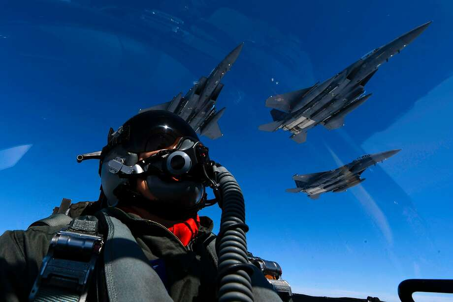 """This handout photo taken and released by the US Air Force on July 30, 2017 shows a US Air Force pilot as US Air Force B-1B Lancers (not pictured) join up with Republic of Korea air force F-15s during a 10-hour mission from Andersen Air Force Base, Guam, into Japanese airspace and over the Korean Peninsula. American forces on July 30 successfully tried out a missile interception system the US hopes to set up on the Korean peninsula, military officials said following a trial just days after North Korea's second test of an ICBM. / AFP PHOTO / US AIR FORCE / Kamaile CASILLAS / RESTRICTED TO EDITORIAL USE - MANDATORY CREDIT """"AFP PHOTO / AIR FORCE PHOTO / KAMAILE CASILLAS """" - NO MARKETING NO ADVERTISING CAMPAIGNS - DISTRIBUTED AS A SERVICE TO CLIENTS  KAMAILE CASILLAS/AFP/Getty Images Photo: KAMAILE CASILLAS, AFP/Getty Images"""