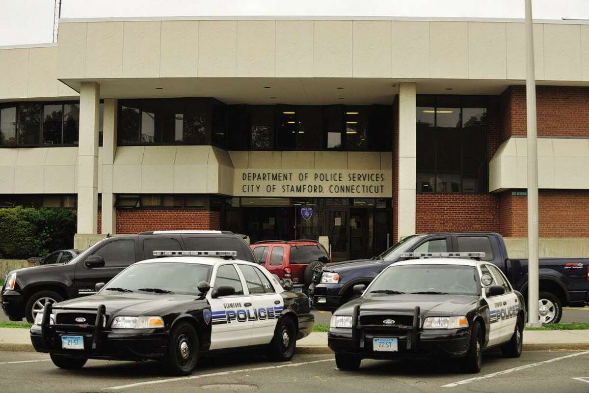 Police cruisers are parked in front of the Stamford police station at 805 Bedford St. The police department is currently running a $271,000 deficit in its overtime account.