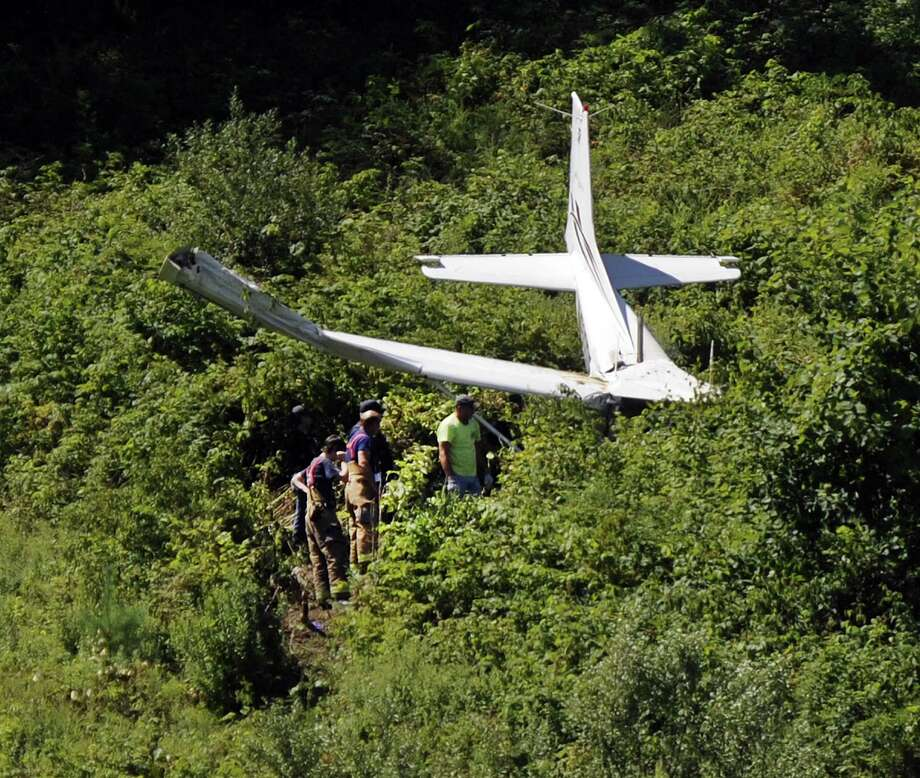 Three people are injured after a plane crashed about a mile from Danbury Airport Sunday morning, police confirmed. The crash occured off Miry Brook Road near the Dog Park around 10:30 a.m, July 30, 2017 Photo: Carol Kaliff / Hearst Connecticut Media / The News-Times