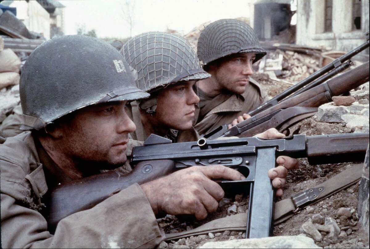 FILE--From left, Tom Hanks as Captain Miller, Matt Damon as Private Ryan and Edward Burns as Private Reiben are seen in a scene from DreamWorks Pictures' and Paramount Pictures'
