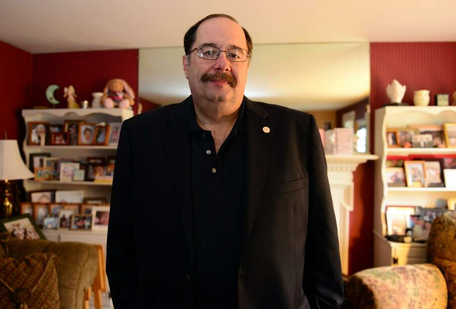 Jonathan Best, who is the Director of the Department of Public Health Office of Preparedness and Response, poses at his home in Stratford, Conn. on Thursday May 15, 2014. In 2001, Best was a supervisor for an ambulance company in Manhattan. He lost several friend in the 9/11 attacks at the World Trade Center. Photo: Christian Abraham / Christian Abraham / Connecticut Post