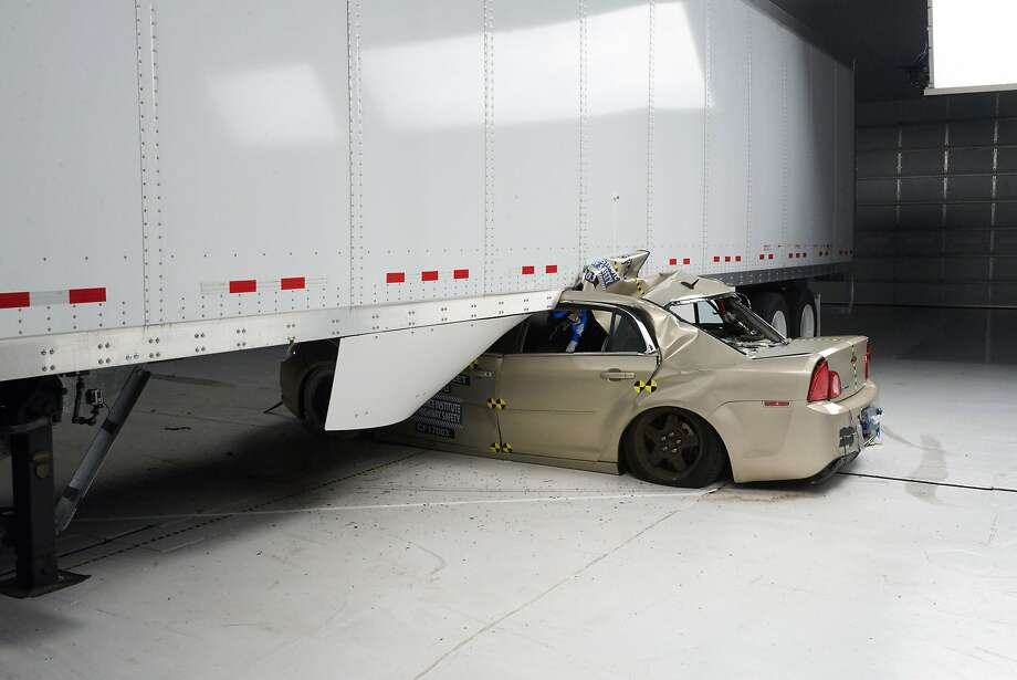 The dam age to a Chevrolet Malibu in a 35 mph underride crash into a tractor- trailer is shown in a photo from the Insurance Institute for Highway Safety. Photo: Associated Press