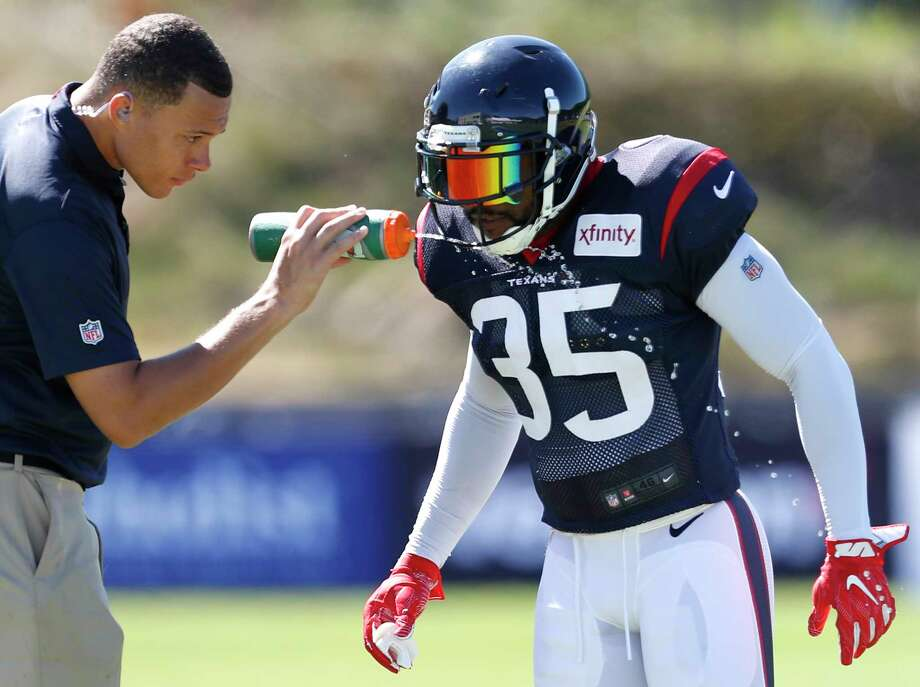 Houston Texans defensive back Eddie Pleasant (35) gets a drink of water during training camp at the Greenbrier on Sunday, July 30, 2017, in White Sulphur Springs, W.Va. Photo: Brett Coomer, Houston Chronicle / © 2017 Houston Chronicle}
