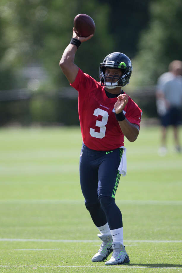 Seahawks quarterback Russell Wilson throws a pass during the first day of practice on Sunday, July 30, 2017. Photo: GRANT HINDSLEY, SEATTLEPI.COM / SEATTLEPI.COM