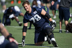 Seahawks guard Luke Joeckel stretches during the first day of practice on Sunday, July 30, 2017.