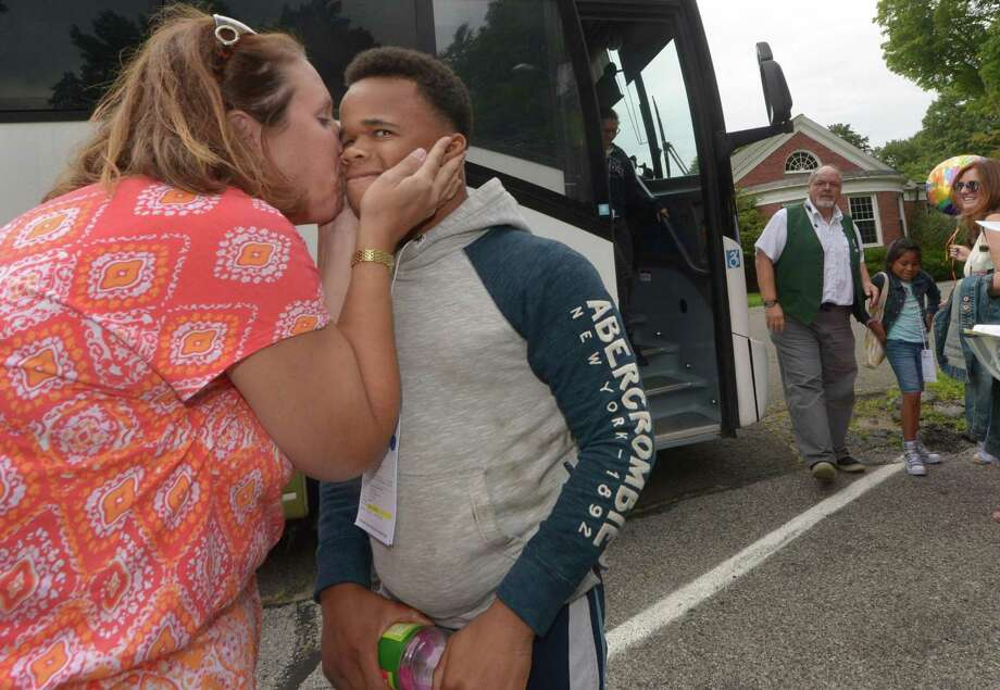 Volunteer host families with The Southwest Coast CT Committee of the Fresh Air Fund like Darien resident Karen Brennan welcome New York City children including her returning guest Jaheim McLorrain, 14, as they arrive to share two weeks of their summer Saturday, July 29, 2017, at the First Congregational Church in Darien, Conn. The Fresh Air Fund is an independent, not-for-profit agency that has provided free summer experiences to more than 1.8 million New York City children from low-income communities since 1877. Each summer, thousands of children visit volunteer host families in rural, suburban and small town communities along the East Coast and Southern Canada through The Fresh Air Funds Friendly Towns Program. Photo: Erik Trautmann / Hearst Connecticut Media / Norwalk Hour