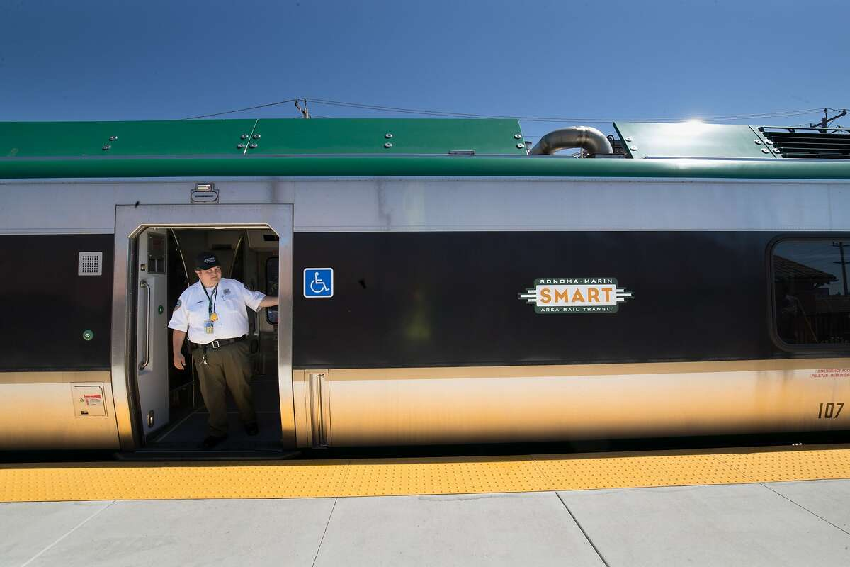 Conductor Engineer Tim Dulin at the doors of a testing Smart train at the Petaluma train station, part of the Sonoma-Marin Area Rail Transit System on Sunday, July 30, 2017 in Petaluma, CA.