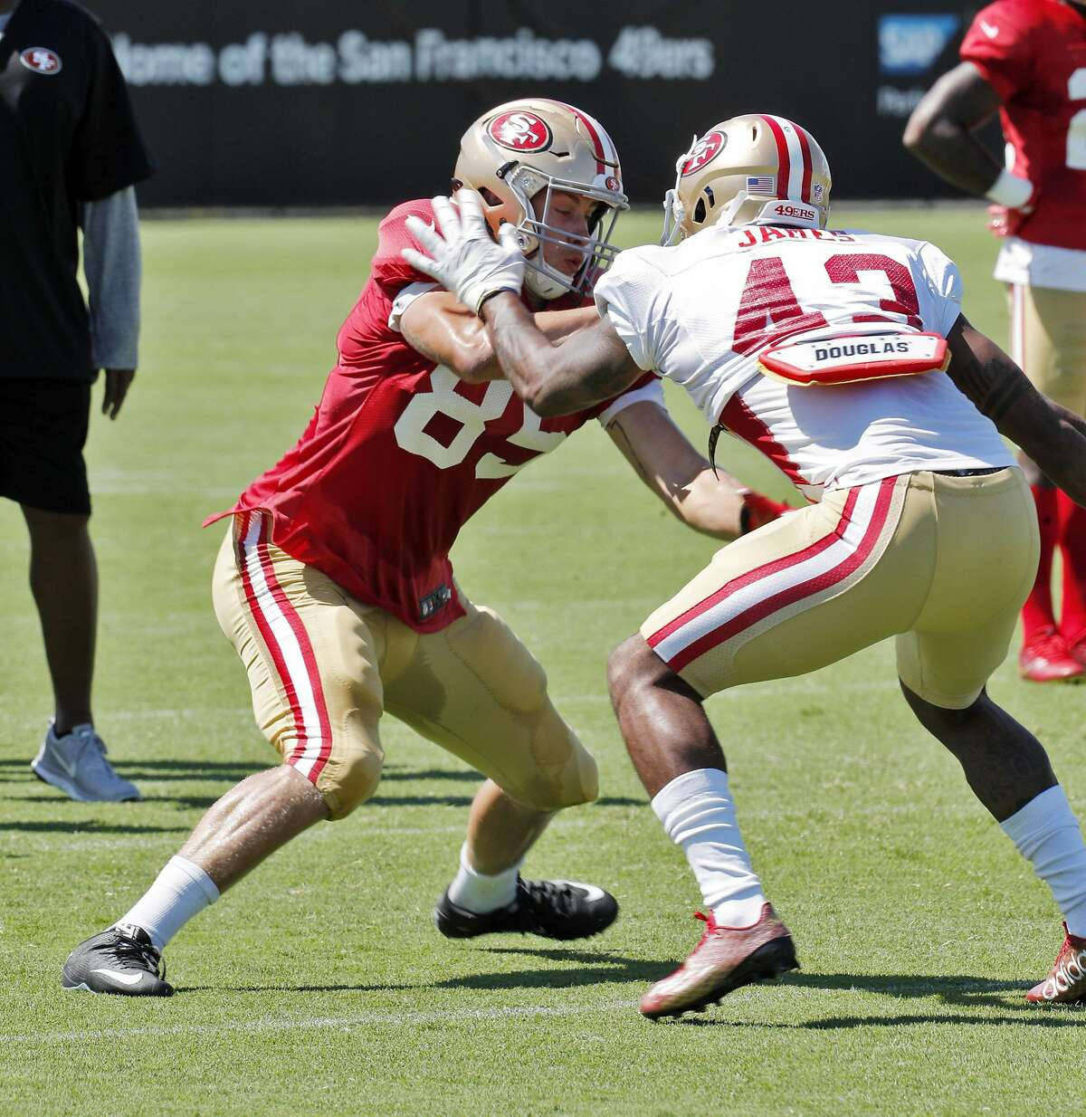 George Kittle (85) squares up against Chanceller James (43) during practice at Levi's Stadium in Santa Clara, Calif., on Sunday, July 30, 2017.