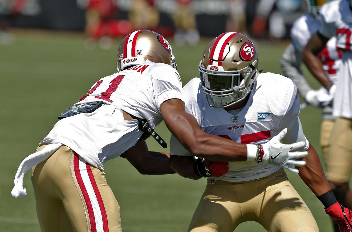 Ahkello Witherspoon (41) right, squares up against Eric Reid (35) during practice at Levi's Stadium in Santa Clara, Calif., on Sunday, July 30, 2017.