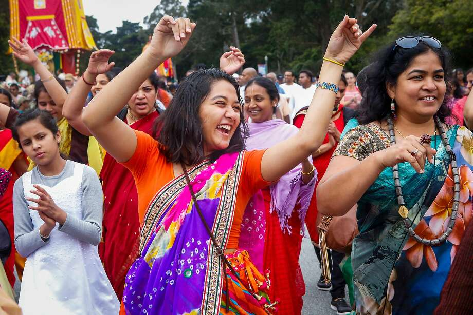 Above: Anushka Srivastava (center) dances and sings during the 51st annual Festival of Chariots, or Ratha Yatra as it is known in India. Worshipers and bystanders help pull the three carts, or chariots, bearing the likenesses of Lord Jagannath, or Krishna; his brother, Lord Baladeva, and his sister, Subhadra. Photo: Nicole Boliaux, The Chronicle