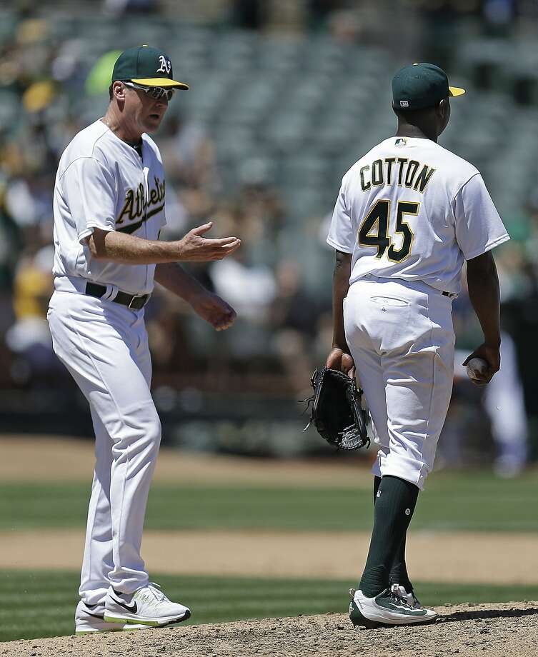 Oakland Athletics manager Bob Melvin, left, relives pitcher Jharel Cotton (45) in the fourth inning of a baseball game against the Minnesota Twins, Sunday, July 30, 2017, in Oakland, Calif. (AP Photo/Ben Margot) Photo: Ben Margot, Associated Press