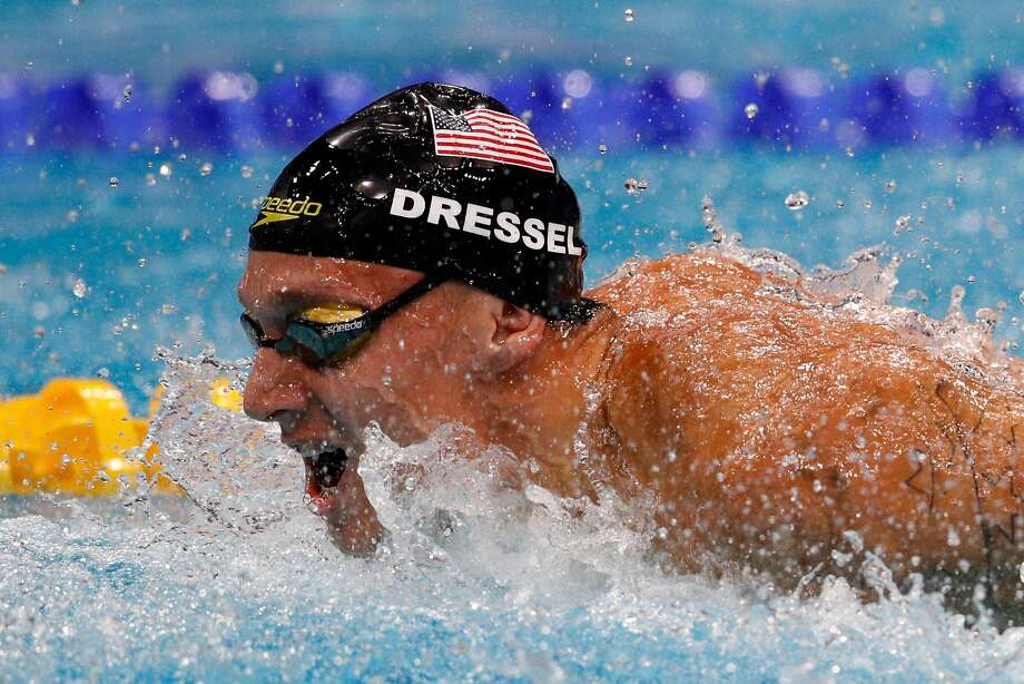Caeleb Dressel regains the lead for the U.S. in the men's 4x100 meter medley relay final at the worlds. Photo: Adam Pretty, Getty Images