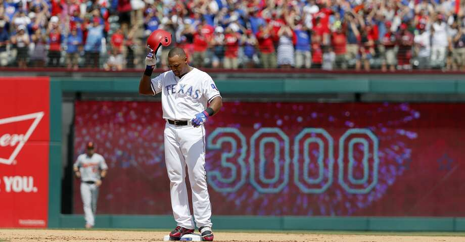 Texas Rangers' Adrian Beltre tips his helmet as he acknowledges cheers after hitting a double for his 3,000th career hit that came off a pitch from Baltimore Orioles' Wade Miley in the fourth inning of a baseball game, Sunday, July 30, 2017, in Arlington, Texas. (AP Photo/Tony Gutierrez) Photo: Tony Gutierrez/Associated Press