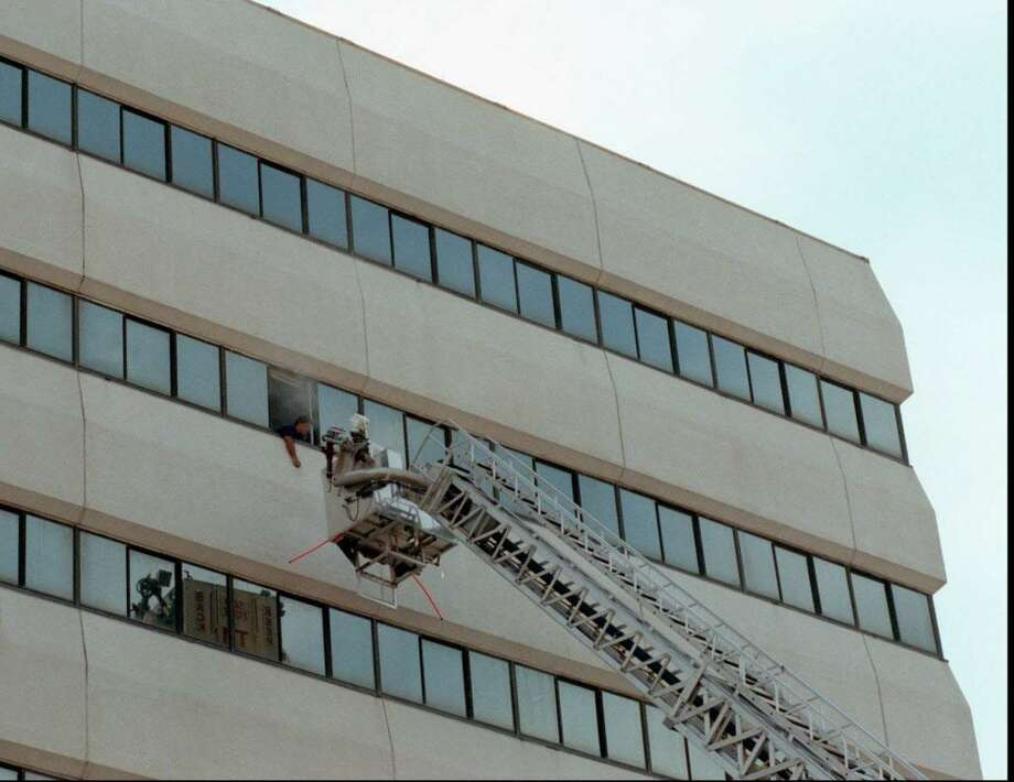 Stamford Fire Department held a high rise drill yesterday morning at the Pitt building on Washington Blvd.  The building next to Swiss Bank is scheduled for demolition next month.  The Tower ladder approached a 'victim ' hanging out of a smoke filled office on the eighth floor.  Jun 14, 97 Tom Ryan/Staff Photo Photo: ST