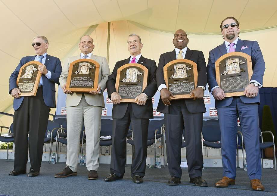 CORRETCS NAME TO JOHN SCHUERHOLZ-Newly-inducted National Baseball Hall of Famers from left, Bud Selig, Ivan Rodriguez, John Schuerholz, Tim RainesSr., and Jeff Bagwell hold their plaques after an induction ceremony at the Clark Sports Center on Sunday, July 30, 2017, in Cooperstown, N.Y. (AP Photo/Hans Pennink) Photo: Hans Pennink, Associated Press