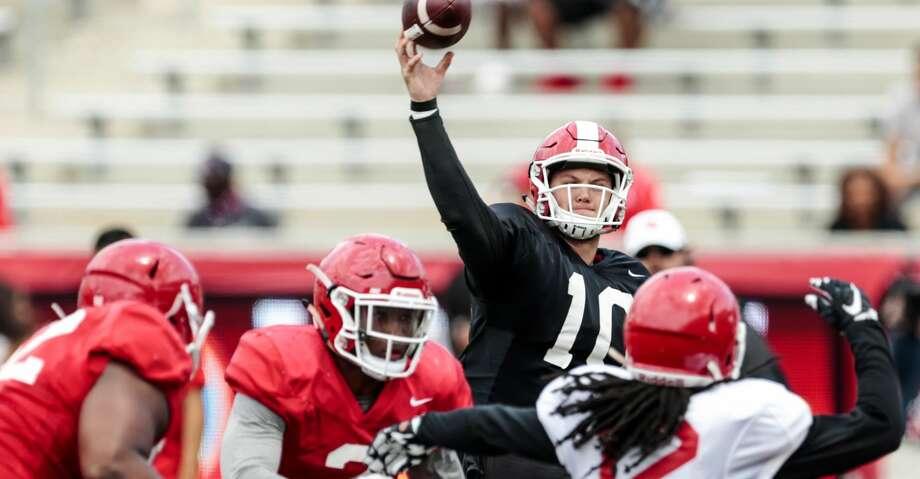 Houston quarterback Kyle Allen (10) throws a pass over linebacker d'Juan Hines (12) during the University of Houston Red-White Game at TDECU Stadium on Saturday, April 15, 2017, in Houston. ( Brett Coomer / Houston Chronicle ) Photo: Brett Coomer/Houston Chronicle
