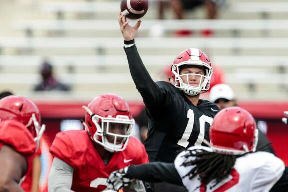 Houston quarterback Kyle Allen (10) throws a pass over linebacker d'Juan Hines (12) during the University of Houston Red-White Game at TDECU Stadium on Saturday, April 15, 2017, in Houston. ( Brett Coomer / Houston Chronicle )
