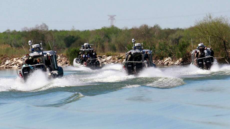 A group of U.S. Customs and Border Protection boats travel the Rio Grande Wednesday, Feb. 22, 2017 south of Mission, Texas. U.S. Speaker of the House Paul Ryan and Rep. Michael McCaul, R-Texas, toured the Texas border with Mexico by air and boat, as well as U.S. Border Patrol facilities in the area. (Nathan Lambrecht/The Monitor via AP) Photo: Nathan Lambrecht, Associated Press / The Monitor