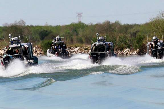 A group of U.S. Customs and Border Protection boats travel the Rio Grande Wednesday, Feb. 22, 2017 south of Mission, Texas. U.S. Speaker of the House Paul Ryan and Rep. Michael McCaul, R-Texas, toured the Texas border with Mexico by air and boat, as well as U.S. Border Patrol facilities in the area. (Nathan Lambrecht/The Monitor via AP)