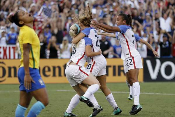 United States defender Julie Ertz (8) celebrates with teammates after scoring as Brazil midfielder Maria, left, reacts during the second half of a Tournament of Nations women's soccer match Sunday, July 30, 2017, in San Diego. The United States won, 4-3. (AP Photo/Gregory Bull)