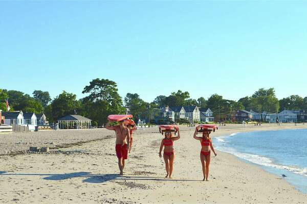 Lifeguards come down the beach to be available for swimmers at the 39th annual Westport Weston Family YMCA's Point-to-Point Compo Beach Swim, Sunday, July 30, 2017, in Westport, Conn.
