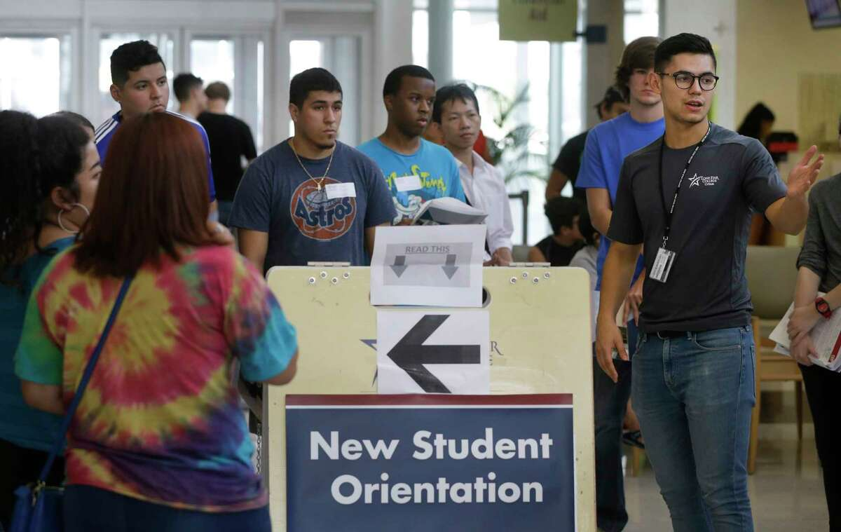 Diego Zaragoza, right, leads a tour of new student during orientation at Lone Star College-CyFair, 9191 Barker Cypress Rd., Tuesday, July 25, 2017, in Cypress.