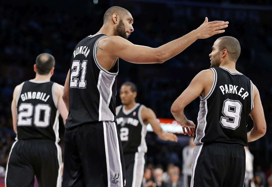 Manu Ginobili (from left), Tim Duncan, Kawhi Leonard and Tony Parker have been the keys to the Spurs winning at 60-percent clip over the past 20 seasons. Photo: Edward A. Ornelas /San Antonio Express-News / © 2013 San Antonio Express-News