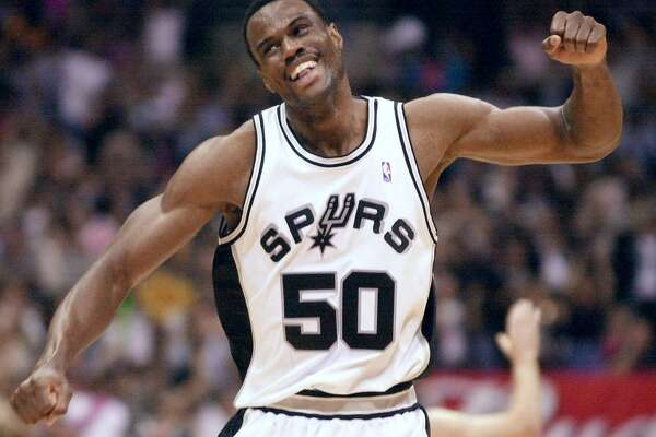 Spurs center David Robinson celebrates during the fourth quarter of their Western Conference semifinal game against the Dallas Mavericks on May 7, 2001.