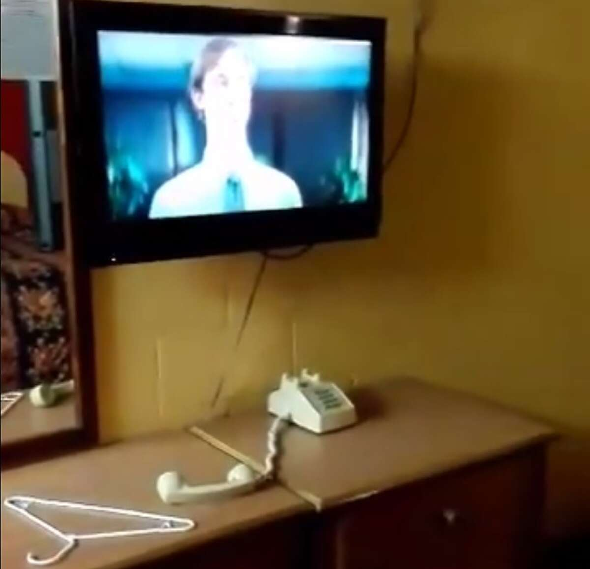 Potus Frank Ramirez posted a video on Facebook about a hotel room he believed to be haunted in South Texas. In the video, the ghost unsaddles the corded phone, moves a towel and knocks off a hanger from a dresser. Image source: Facebook