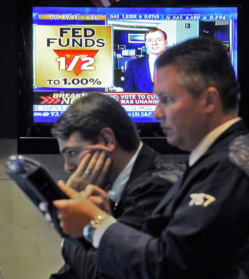 A television screen in a booth on the floor of New York Stock Exchange shows the rate decision by the Federal Reserve Board Wednesday, Oct. 29, 2008. (AP Photo/Richard Drew) Photo: RICHARD DREW / AP