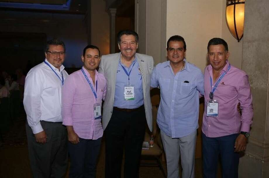 The two Laredos came together in Cancun at the Mexican National Conference of Customs Brokers. Pictured from left to right are: Horacio De Leon, Jr., Interim City Manager; Edgardo Pedraza, President of the Association of Nuevo Laredo Customs Brokers; Laredo Mayor Pete Saenz; Presidente Municipal de Nuevo Laredo Enrique Rivas Cuellar; Manuel Canales, Vice President of the Association of Nuevo Laredo Customs Brokers.  Photo: Courtesy