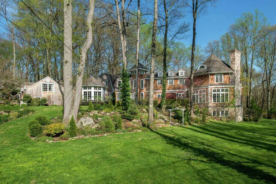 The shingle-style colonial house at 301 Old Norwalk Road is located on a 2.39-acre level and sloping property at the end of a cul-de-sac on a private road. / © SR Photo, LLC All Rights Reserved