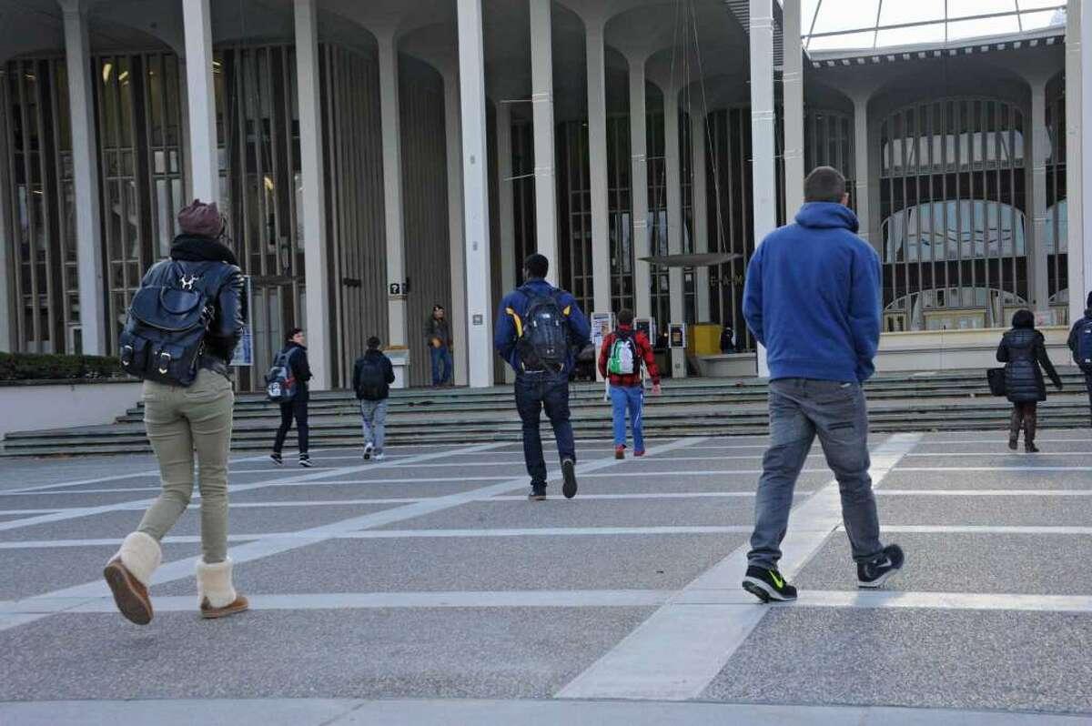 University at Albany students walk from classes at UAlbany Tuesday, Nov. 18, 2014